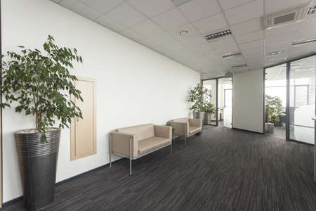 reception desk: Interior of a modern office, corridor with two sofa Stock Photo