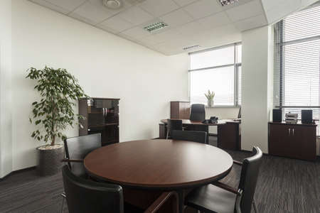 Round table in modern office, conference hall Stock Photo - 19505310