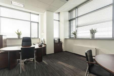 Interior of a new contemporary office, table Archivio Fotografico