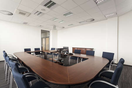 office appliances: Huge round conference table in modern office Stock Photo