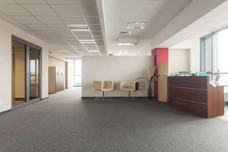 Spacious room in an office building, modern interior photo