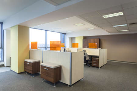 places of work: Work place and desks in a modern office interior Stock Photo