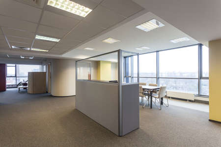 big windows: Office with huge window and spacious interior