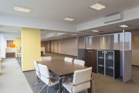 seating furniture: Interior of a modern office building, empty room Stock Photo