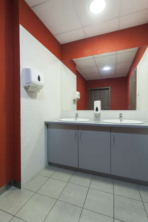 Interior of a red and white bathroom, vertical photo