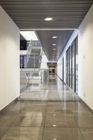 booking: Spacious interior of a modern office building