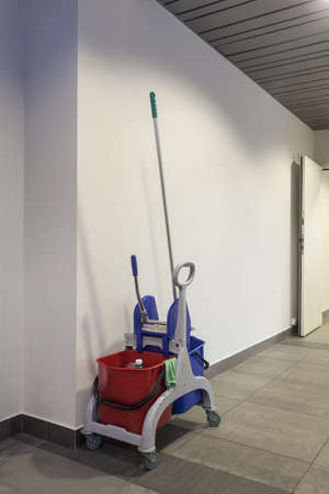 Equipment for cleaning standing in modern office interior photo