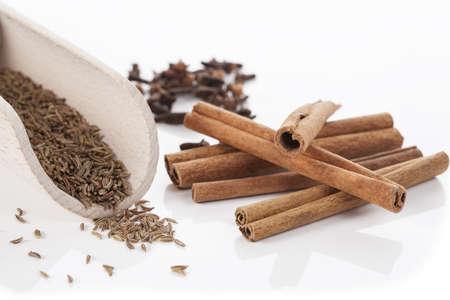 clove of clove: Cinnamon, cumin and cloves on isolated background