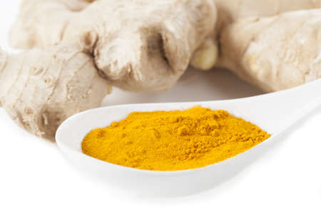Hot oriental spices: ginger and turmeric, isolated photo