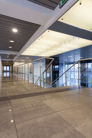 company building: Modern glass interior with futuristic appearance Stock Photo