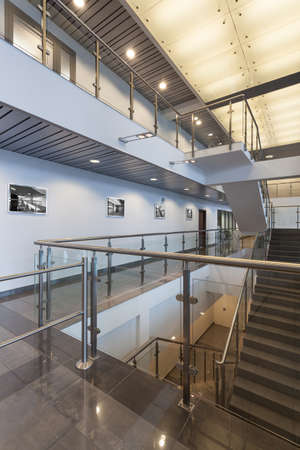 Modern staircase with glass banister in a office centre photo