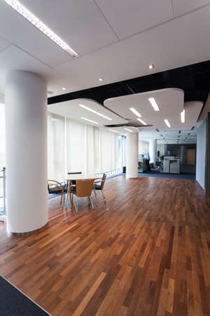 office appliances: Luxurious office with designers lighting and exotic wooden floor