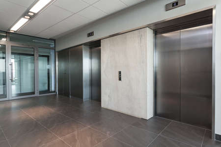 lift gate: Shining silver elevator in a modern office building