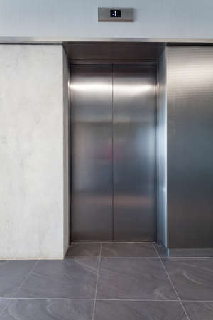 Silver lift door in a business centre Stock Photo - 19688911