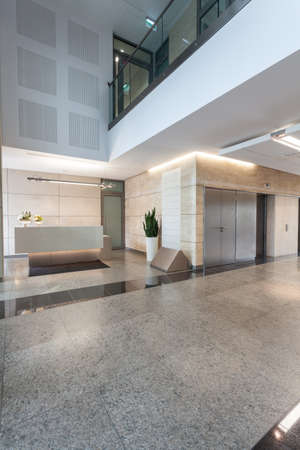 headquarter: Reception and main hall in modern office building Stock Photo