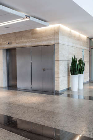 company building: Modern silver lift in a new office building