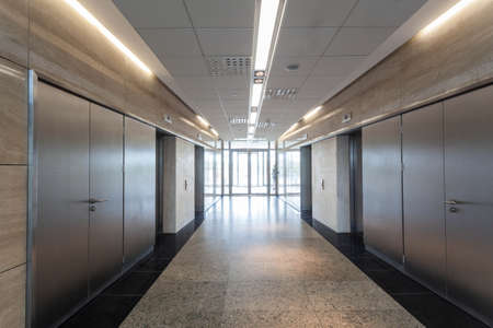 Entrance and corridor in a modern building interior photo