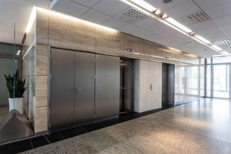 Modern interior of office, corridor and lift photo