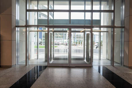 glass doors: Glass entrance to new modern business centre Stock Photo