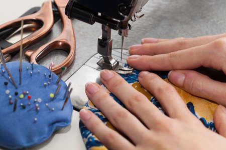stitching machine: Tailor sewing on a sewing machine