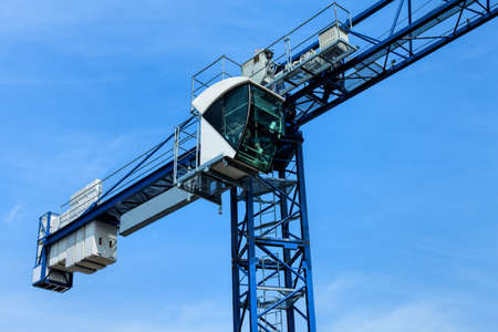 heavy equipment operator: Huge crane on the background of a blue sky