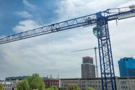 Crane at the blue sky, construction site photo