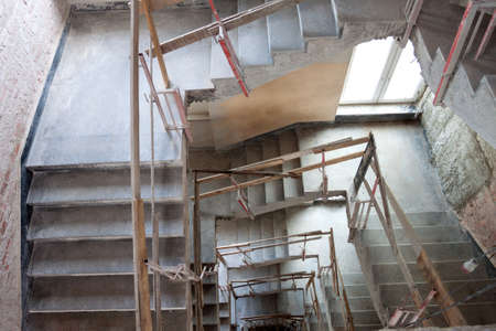 Construction of a lift shaft with staircase, bird eye view. photo