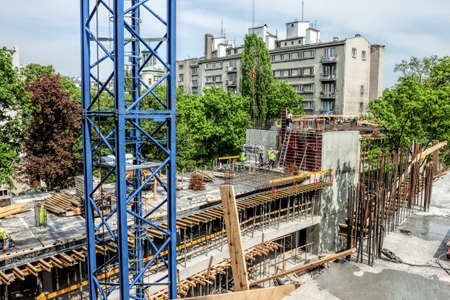roof beam: Crane and unfinished building, modern construction