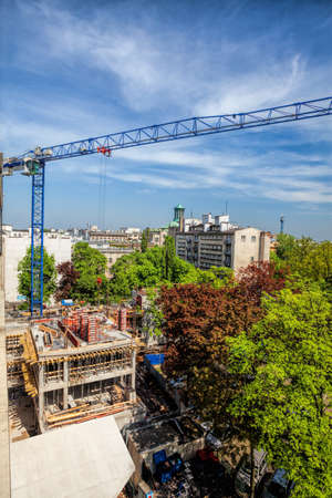 Concrete construction and a huge crane above Stock Photo - 19913379