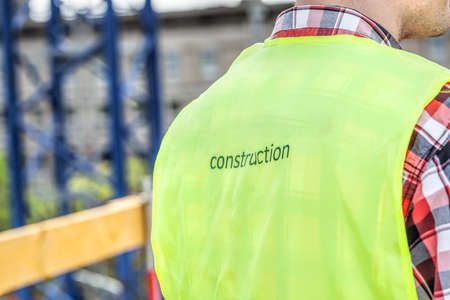 Closeup of a construction manager with a special vest photo