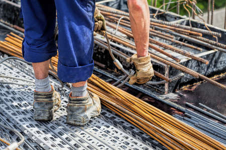 Closeup of a constructor standing on a rods Stock Photo - 19913374