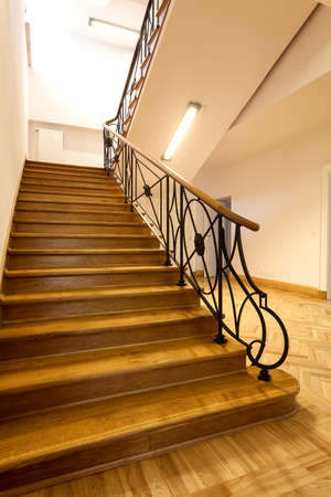Wooden stairs in a classic elegant interior photo