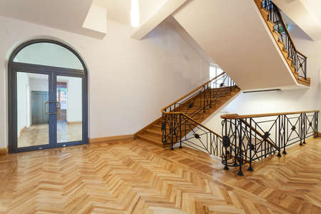 Classical interior, wooden hall with a staircase Stock Photo - 19977352