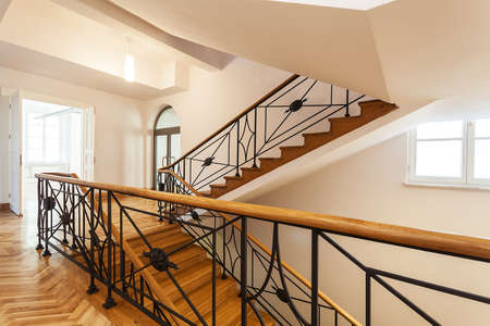 Palace wooden staircase with an ornamental metal banister Stock Photo - 19977354