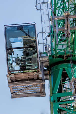Operator's cabine of a crane at sky background Stock Photo - 20002918