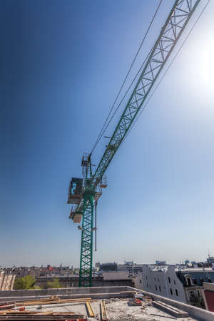 Vertical view of a building site and huge crane photo