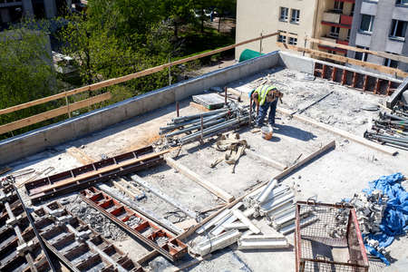 ceiling slab: Worker on a building site, roof