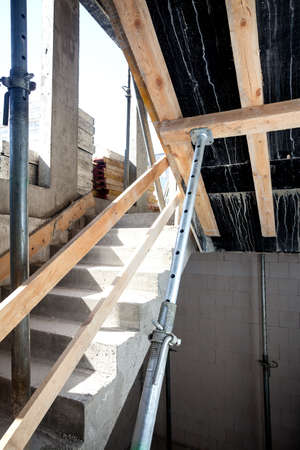 Metal pipes supporting concrete stairs construction photo