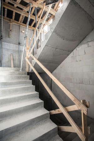 Interior of an unfinished construction, staircase photo