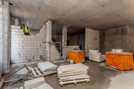 concrete blocks: Interior of a building site with a bricklayer Stock Photo