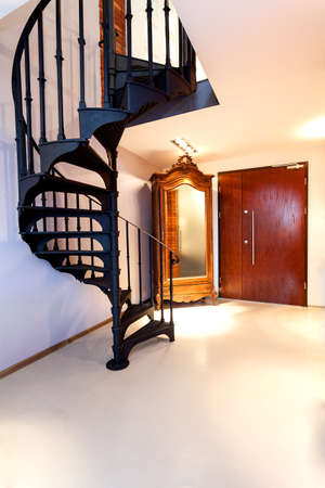 Black spiral staircase in a new elegant inter Stock Photo - 20077439