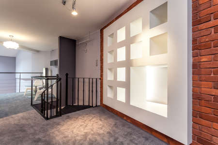 violet residential: Modern white wall in a new original loft