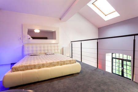 entresol: Purple bedroom on entresol of the loft Stock Photo