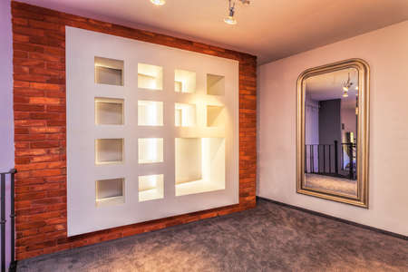 Decorative wall and huge mirror in modern interior photo