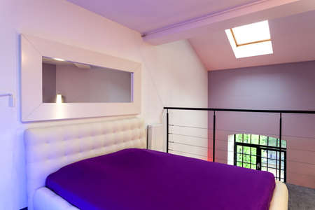 White and violet bed in the loft photo