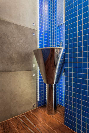 pedestal sink: Closeup of a silver modern washbasin in a bathroom