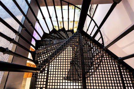 Bird eye view of a metal spiral staircase photo