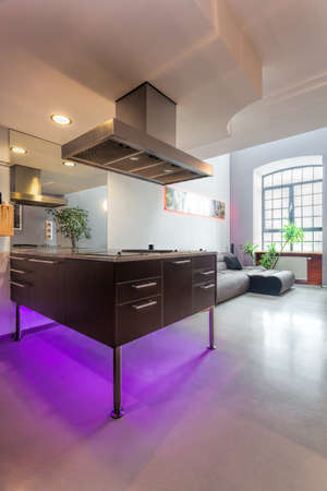 Modern kitchen countertop with violet neon light photo