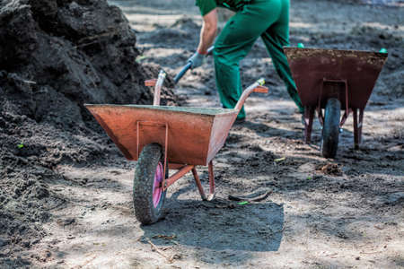 earthwork: Strong worker with a shovel digging heavily