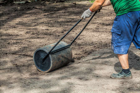 manure: Man is preparing a ground to sow Stock Photo